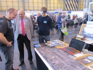 Our Stand at Warley with Tom and Paul discussing the project with a visitor.
